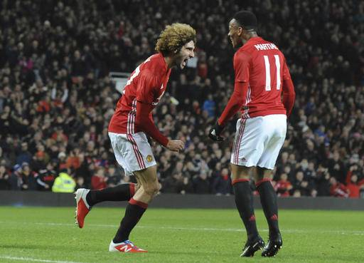 Manchester United's Marouane Fellaini, left, celebrates after scoring his sides second goal during the English League Cup semifinal, 1st leg, soccer match between Manchester United and Hull at Old Trafford stadium in Manchester, England, Tuesday, Jan. 10, 2017. (AP Photo/Rui Vieira)