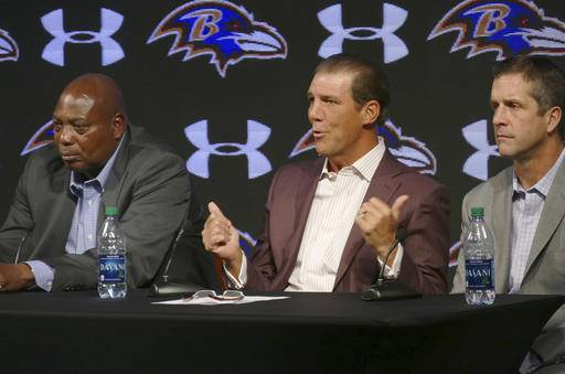 Baltimore Ravens owner Steve Bisciotti, center, speaks as general manager Ozzie Newsome,left, and coach John Harbaugh llisten during an NFL football news conference, Tuesday, Jan. 10, 2017, in Owings Mills, Md. (Kevin Richardson/The Baltimore Sun via AP)