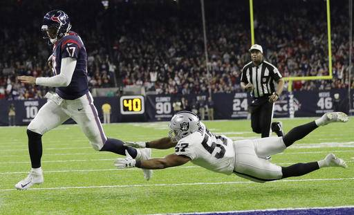 Houston Texans quarterback Brock Osweiler (17) scores on a two-yard run against Oakland Raiders' Cory James (57) during the second half of an AFC Wild Card NFL football game Saturday, Jan. 7, 2017, in Houston. (AP Photo/Eric Gay)