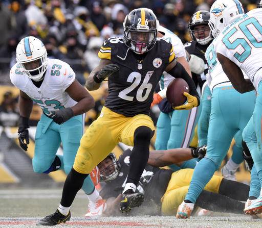 FILE - In this Sunday, Jan. 8, 2017, file photo, Pittsburgh Steelers running back Le'Veon Bell (26) runs during the second half of an AFC Wild Card NFL football game against the Miami Dolphins in Pittsburgh. Ben Roethlisberger's ankle appears to be fine. Considering the way Le'Veon Bell is running, it might not matter. The Steelers have taken a smashmouth approach during the eight-game winning streak that's carried them to the divisional round for a second straight year. (AP Photo/Don Wright, File)