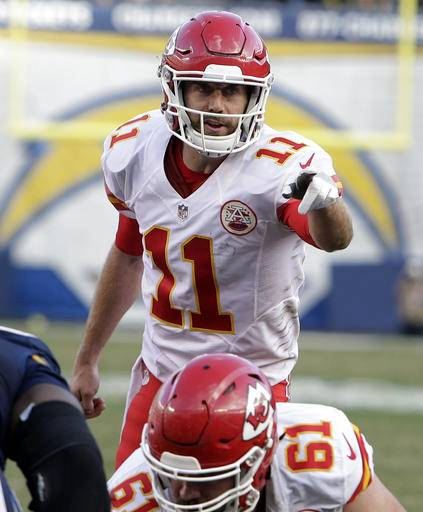 FILE - In this Sunday, Jan. 1, 2017, file photo, Kansas City Chiefs quarterback Alex Smith (11) gestures at the line of scrimmage during an NFL football game against the San Diego Chargers in San Diego. Smith is widely considered average when it comes to NFL quarterbacks, though that's not necessarily a bad thing. He's consistent and rarely makes mistakes. But when it comes to the playoffs, he becomes an entirely different player, bordering on elite. (AP Photo/Rick Scuteri, File)