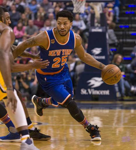 New York Knicks guard Derrick Rose (25) drives the ball into the Indiana Pacer's defense during the first half of an NBA basketball game, Saturday, Jan. 7, 2017, in Indianapolis. (AP Photo/Doug McSchooler)