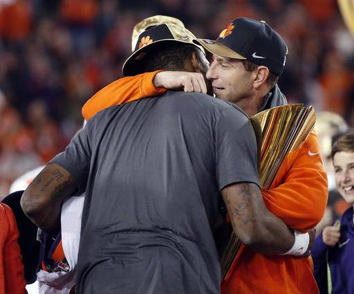 Clemson head coach Dabo Swinney hugs Deshaun Watson after the NCAA college football playoff championship game against Alabama Tuesday, Jan. 10, 2017, in Tampa, Fla. Clemson won 35-31. (AP Photo/John Bazemore)