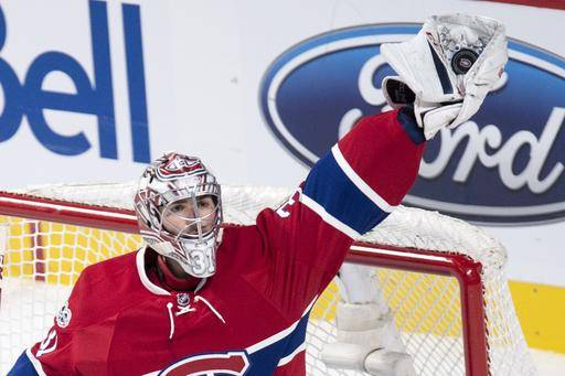 Montreal Canadiens goalie Carey Price reaches out to snag the pack against the Washington Capitals during the third period of an NHL hockey game Monday, Jan. 9, 2017, in Montreal. (Paul Chiasson/The Canadian Press via AP)