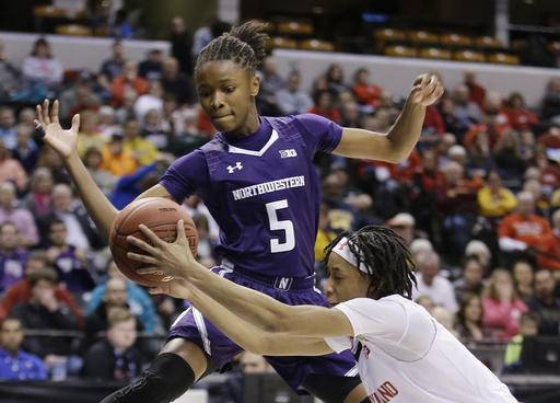 "FILE - In this March 5, 2016, file photo, Maryland's Brene Moseley (3) and Northwestern's Jordan Hankins (5) go for a loose ball during an NCAA college basketball game at the Big Ten Conference tournament in Indianapolis. Hankins has been found dead in her room at the university. The university said in a statement that Hankins' body was found Monday afternoon, Jan. 9, 2017. The statement from spokesman Carsten Parmenter said there is no indication of foul play or ""any danger or threat to other members of the Northwestern community."" (AP Photo/Darron Cummings, File)"