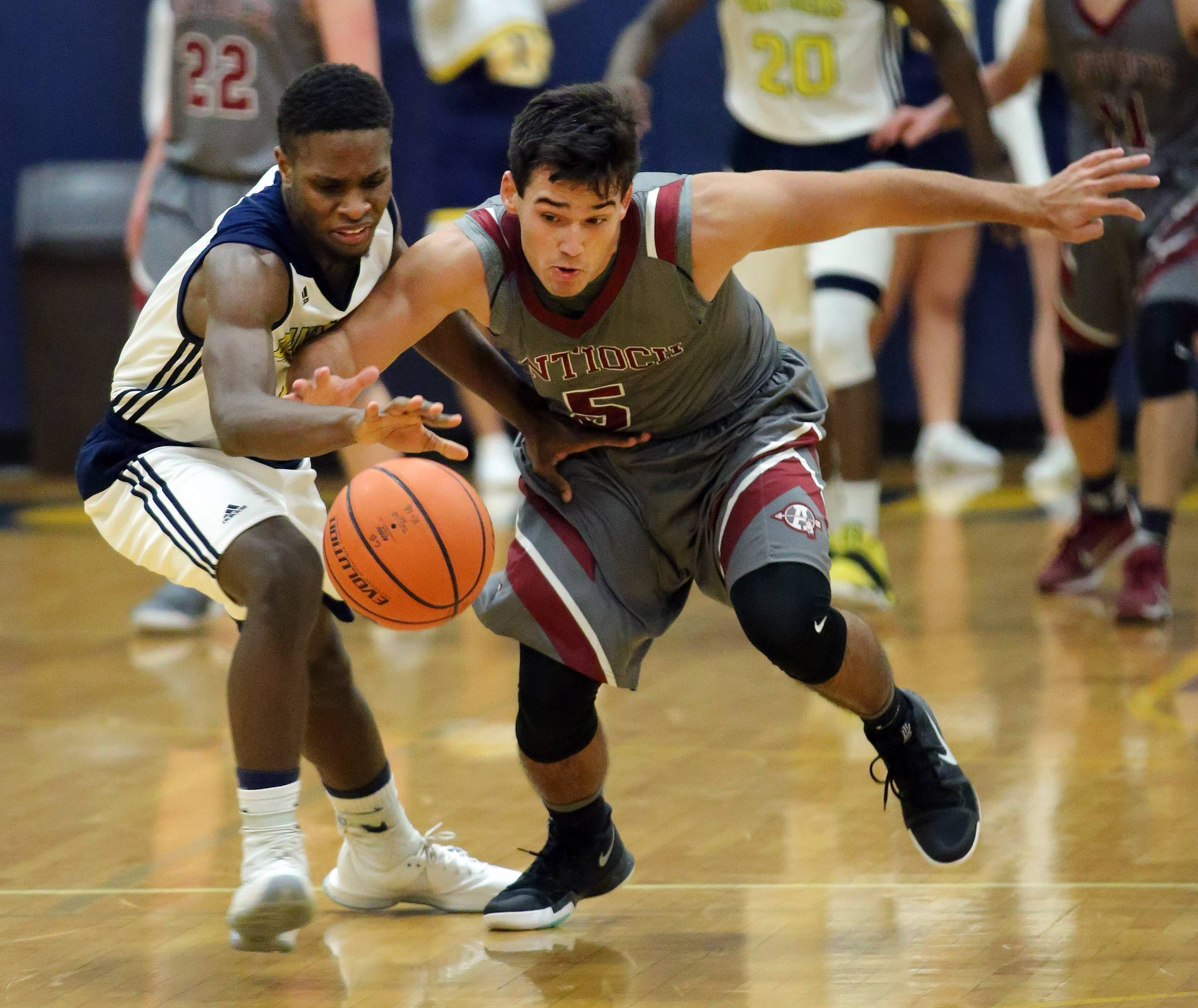 Antioch's Michael Kawell, right, and Round Lake's Angelo White battle for a loose ball during their game Wednesday night in Round Lake.