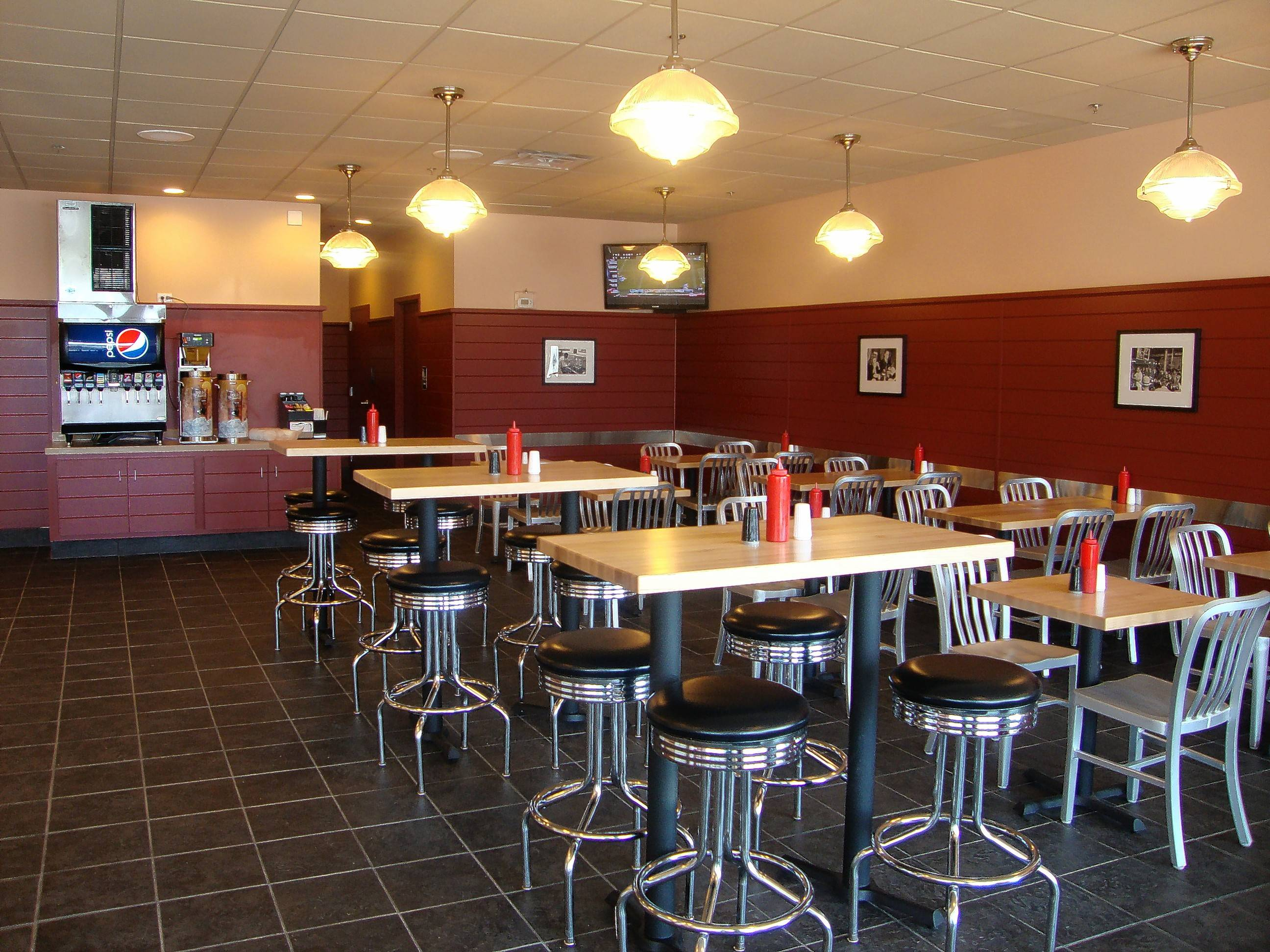 The interior of Wayback Burgers, which opened its first Illinois restaurant last spring in Naperville, takes diners back to a simpler place and time during the era of the classic burger joint.