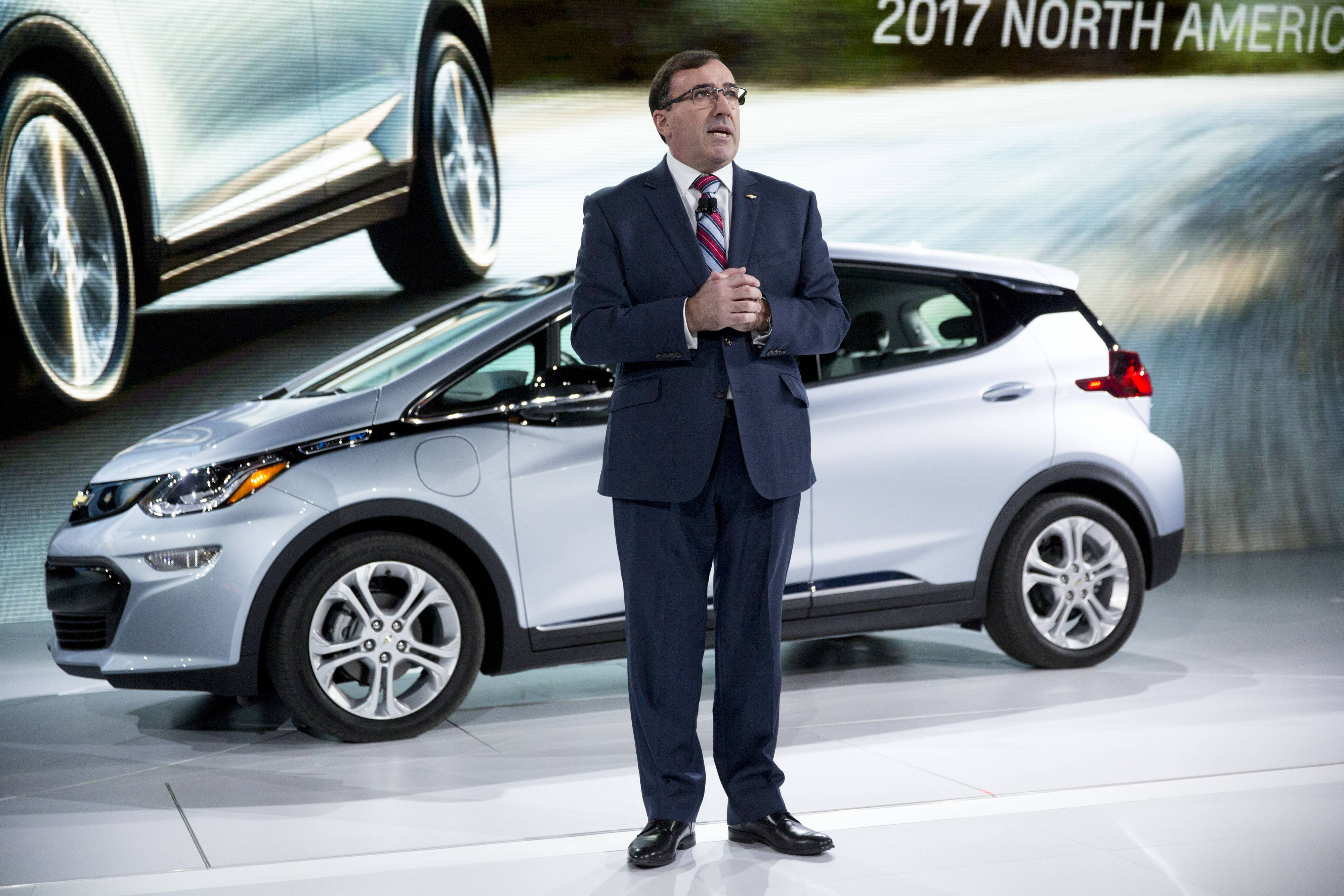 Alan Batey, president of General Motor Co. North America, speaks in front of a Chevrolet Bolt EV vehicle during the 2017 North American International Auto Show in Detroit this week.