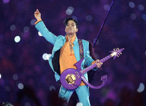 FILE - In this Feb. 4, 2007, file photo, Prince performs during the halftime show at the Super Bowl XLI NFL football game at Dolphin Stadium in Miami. Prince's estate has signed a deal with Global Music Rights, founded by entertainment industry powerhouse Irving Azoff, to represent songs written by the icon. Prince died at his home in Chanhassen, Minn. on April 21, 2016 at the age of 57.