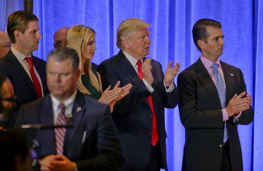 President-elect Donald Trump waits with family members Eric Trump, left, Ivanka Trump and Donald Trump Jr. before speaking at a news conference, Wednesday, Jan. 11, 2017, in New York. The news conference was his first as President-elect. (AP Photo/Seth Wenig)