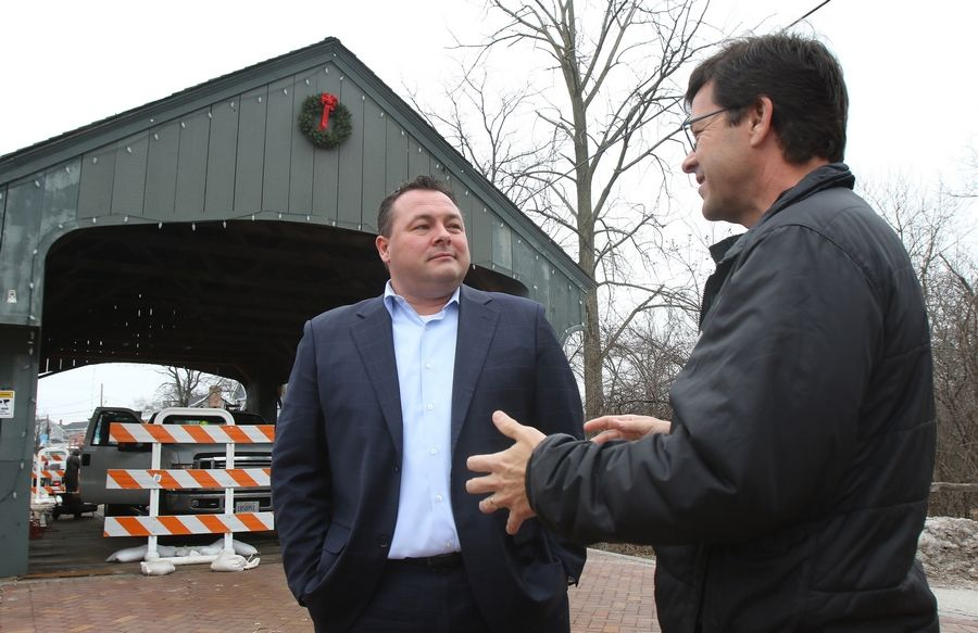 Ryan Messner, chairman of the Historic Downtown Long Grove Business Association executive committee, chats on Wednesday with Aaron Underwood, president of the Long Grove Historical Society. They are part of a campaign to save the village's one-lane covered bridge.