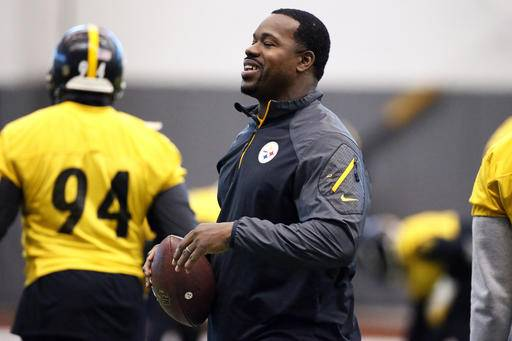 FILE- In this Jan. 13, 2016, file photo, Pittsburgh Steelers assistant coach Joey Porter runs a drill during the NFL football teams' practice in Pittsburgh. Porter has been arrested at a Pittsburgh bar following the team's wild-card win over the Miami Dolphins on Sunday, Jan. 8, 2017.