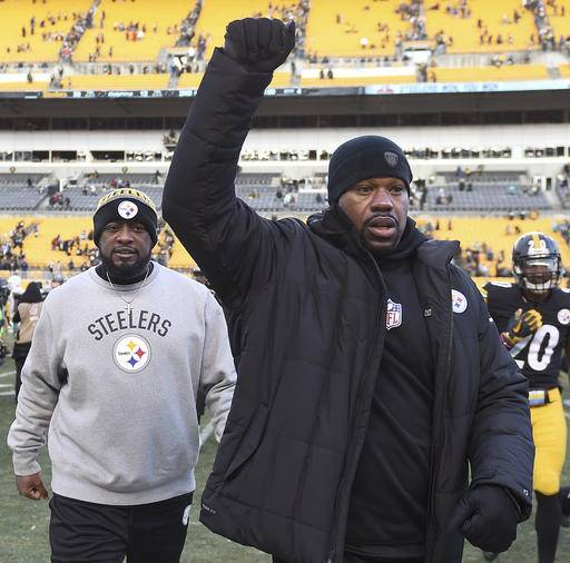 In this  Jan. 8, 2017 photo, Pittsburgh Steelers linebackers coach Joey Porter, right, and head coach Mike Tomlin leave the field after defeating the Miami Dolphins. Porter has been arrested at a Pittsburgh bar following the team's wild-card win over the Miami Dolphins on Sunday, Jan. 8, 2017.  (Christopher Horner/Tribune Review via AP)