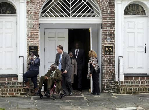 The Rev. Spike Coleman pushes John Pinckney, father of the Rev. Clementa Pinckney, one of the Emanuel Church shooting victims, as they leave  leaves the U.S. District Court on Tuesday, Jan. 10, 2017, in Charleston, S.C. Grace Beahm/The Post And Courier via AP)