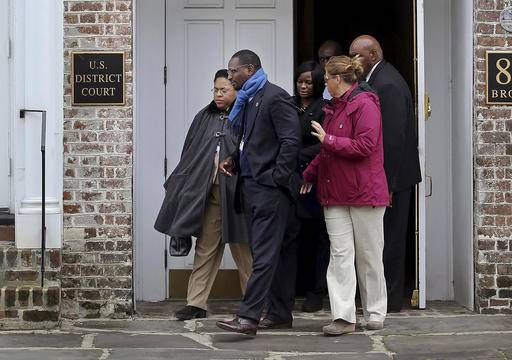 Jennifer Pinckney, widow of the Rev. Clementa Pinckney, one of the Emanuel Church shooting victims, leaves the U.S. District Court with family friend Kylon Middleton on Tuesday, Jan. 10, 2017, in Charleston, S.C. Grace Beahm/The Post And Courier via AP)