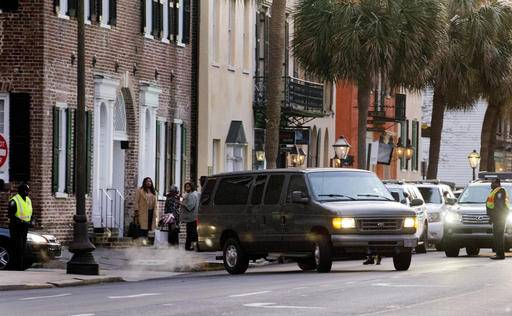 The van carrying Dylann Roof leaves the U.S. District Court on Tuesday, Jan. 10, 2017, in Charleston, S.C. An unrepentant Roof was sentenced to death Tuesday for fatally shooting nine black church members during a Bible study session, becoming the first person ordered executed for a federal hate crime. (Grace Beahm/The Post And Courier via AP)