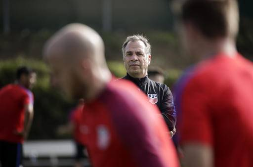 U.S. men's national soccer team coach Bruce Arena watches his team during a practice session Wednesday, Jan. 11, 2017, in Carson, Calif. (AP Photo/Jae C. Hong)