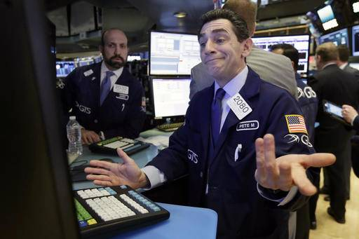 Specialist Peter Mazza works at his post on the floor of the New York Stock Exchange, Thursday, Jan. 12, 2017. U.S. stocks moved broadly lower in early trading Thursday, giving back the market's gains from the day before. (AP Photo/Richard Drew)