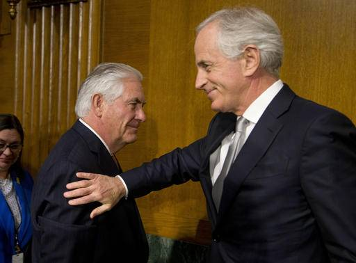 Sen. Bob Corker, R-Tenn., chairman of the Senate Foreign Relations Committee,, right, pats Secretary of State-designate Rex Tillerson , left, on the shoulder after his testimony before the Senate Foreign Relations Committee on Capitol Hill in Washington, Wednesday, Jan. 11, 2017,