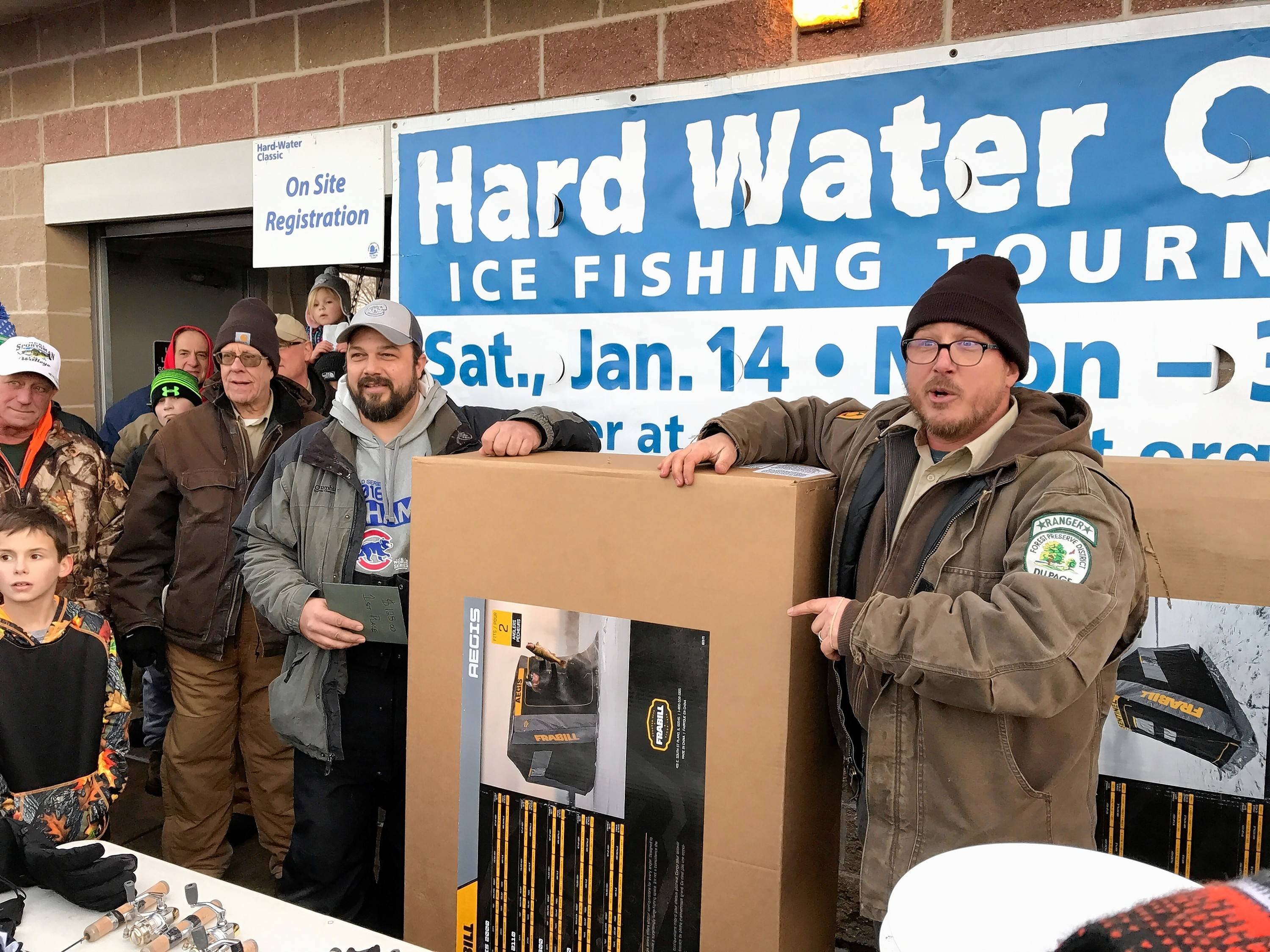 Matt Wolfe, left, was named the grand winner of the Hard Water Classic ice fishing tournament at Blackwell Forest Preserve Saturday. Wolfe, of Frankfort, reeled in a 37.5-inch northern pike.