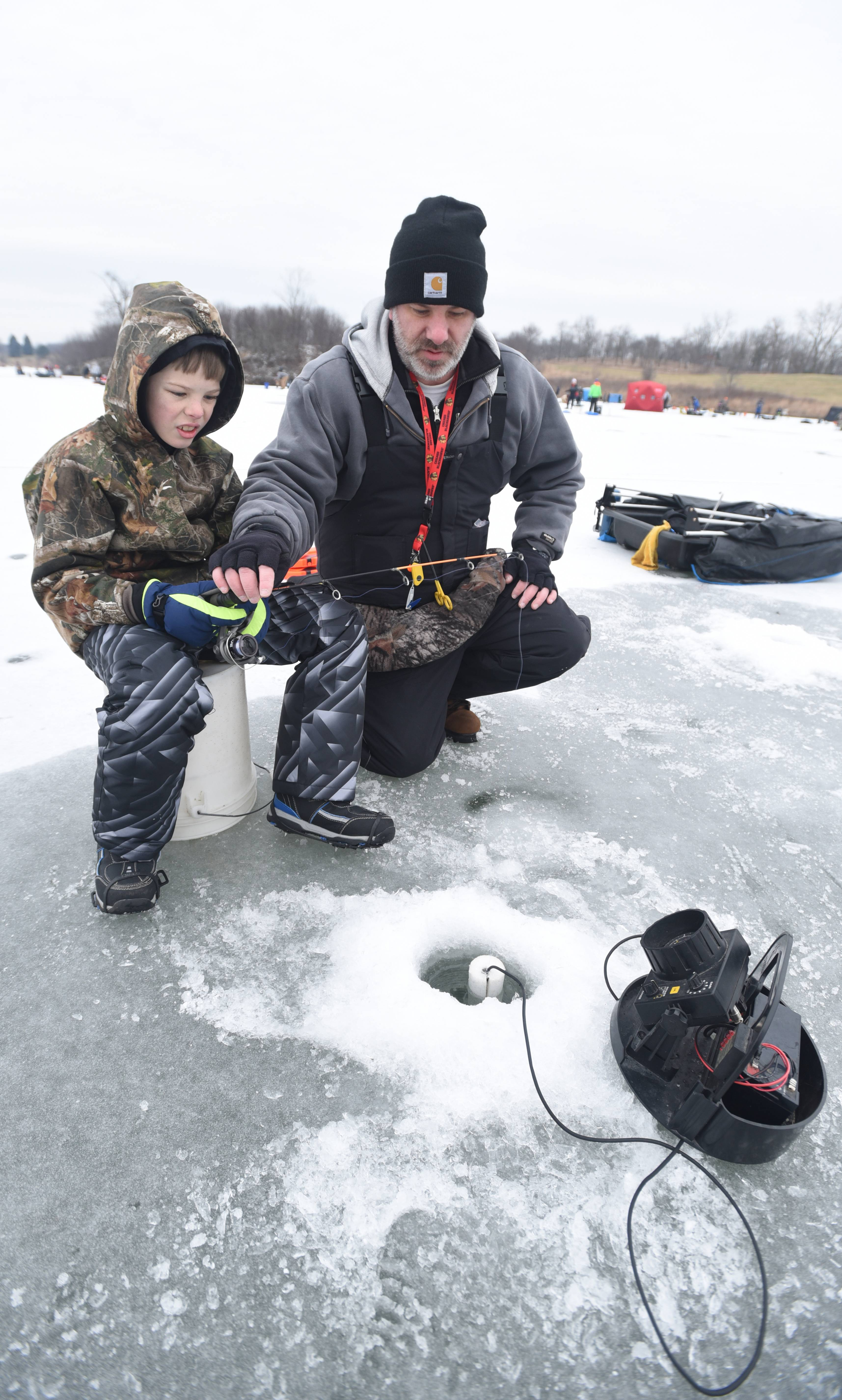 Paul Michna/pmichna@dailyherald.comPatrick Barnat,11, of Plainfield and his uncle Ed Barnat of Downers Grove fish the day away.The DuPage County Forest Preserve District will sponsor its Hard Water Classic ice fishing tournament from noon to 3:30 p.m. Saturday, Jan. 14, on the 62-acre Silver Lake at Blackwell Forest Preserve in Warrenville