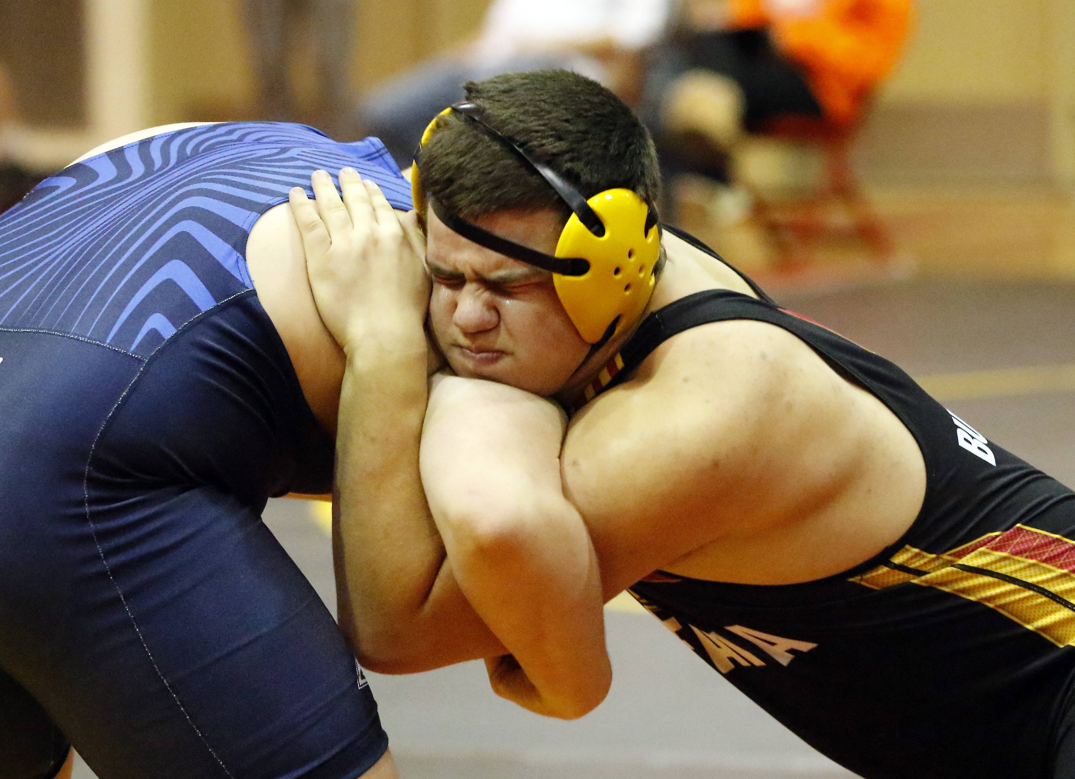 Batavia's Jack Darby, right, wrestles Plainfield South's Andrew Stachniak at 220 pounds Saturday during the Batavia Invite wrestling meet.