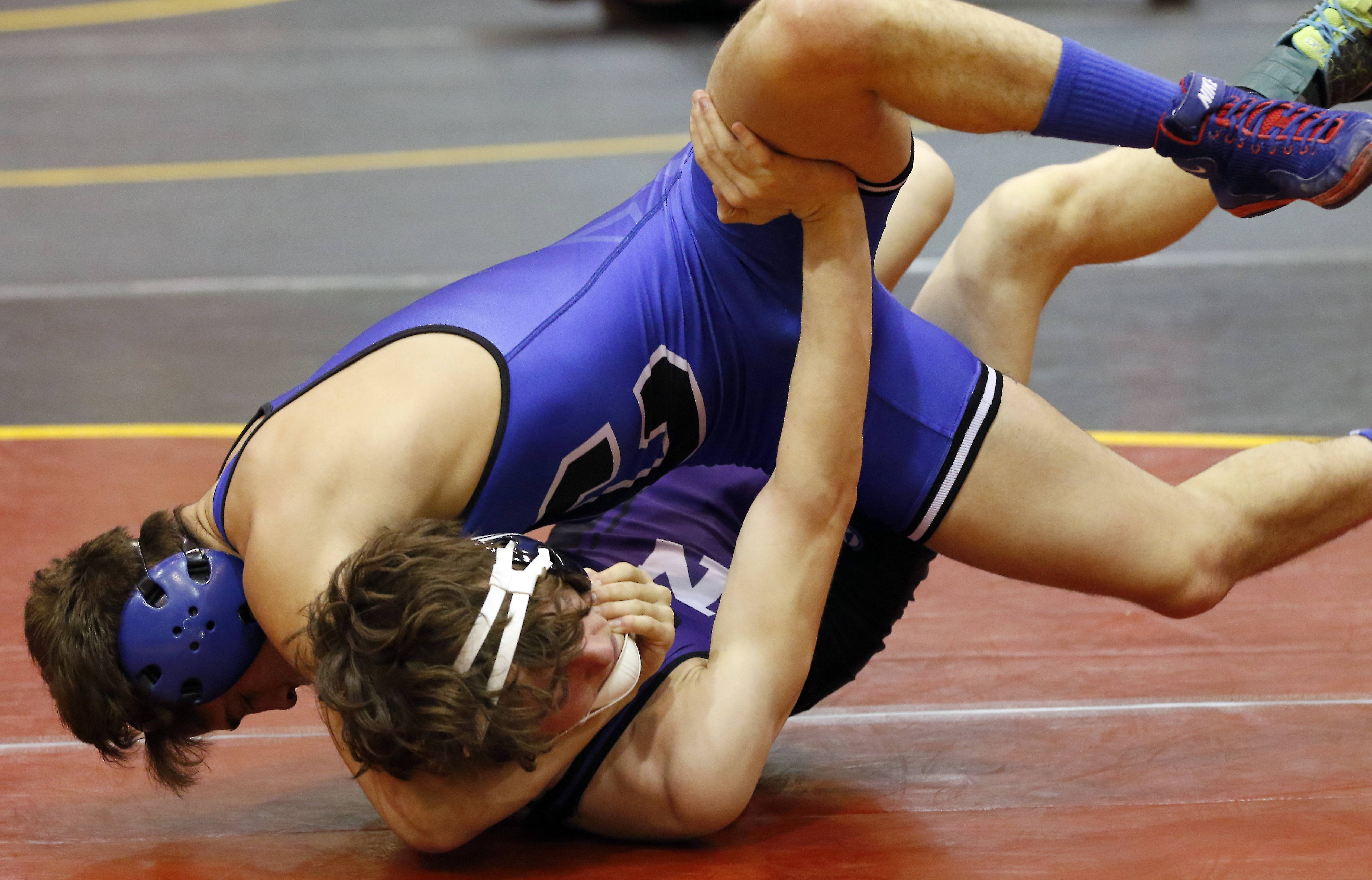 Burlington Central's Austin Macias, top, wrestles Downers Grove North's Bert Baker at 126 pounds Saturday during the Batavia Invite wrestling meet.