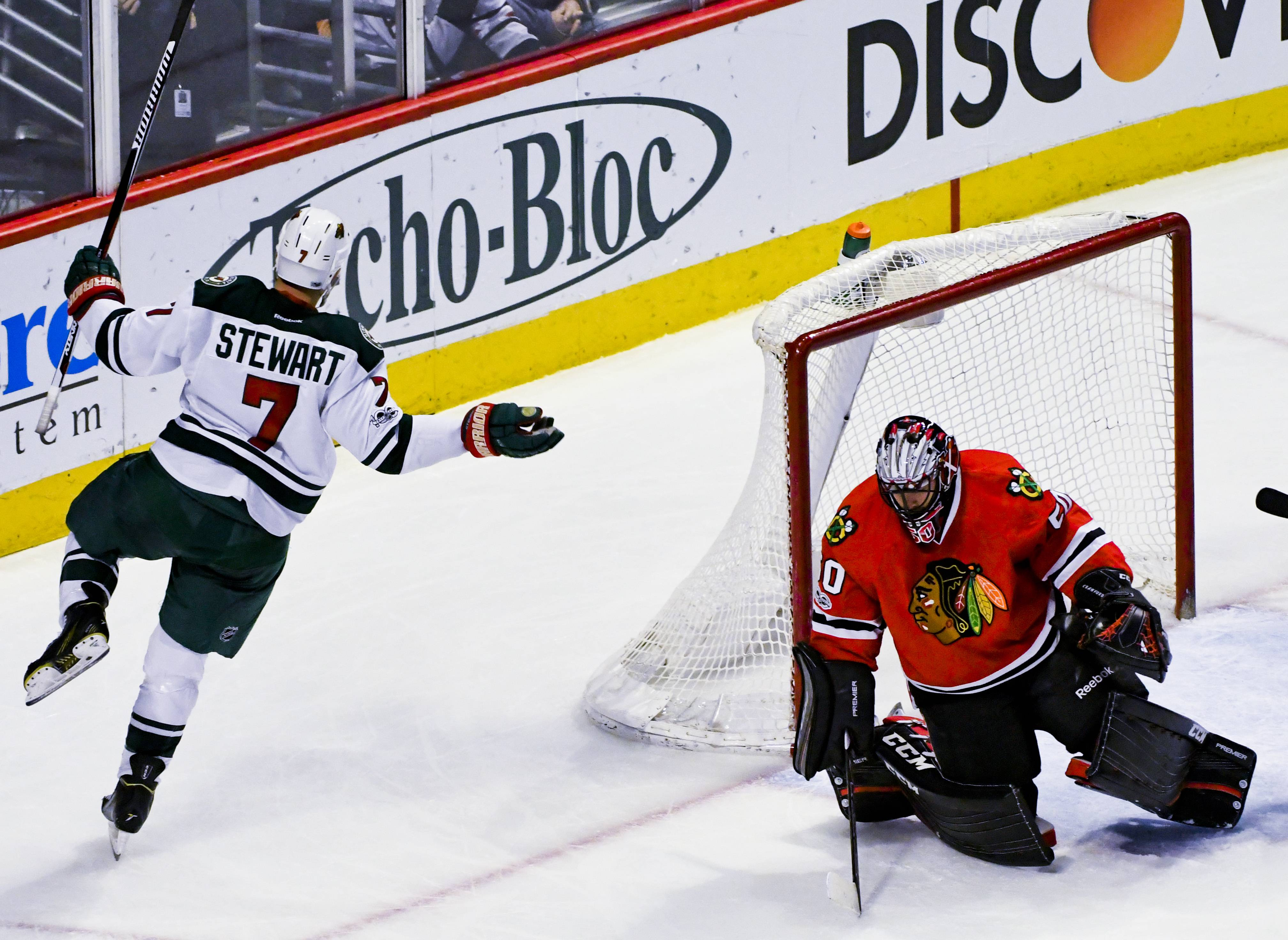 Minnesota Wild right wing Chris Stewart (7) celebrates his goal as Chicago Blackhawks goalie Corey Crawford (50) looks on during the second period of an NHL hockey game on Sunday, Jan. 15, 2017, in Chicago. (AP Photo/Matt Marton)
