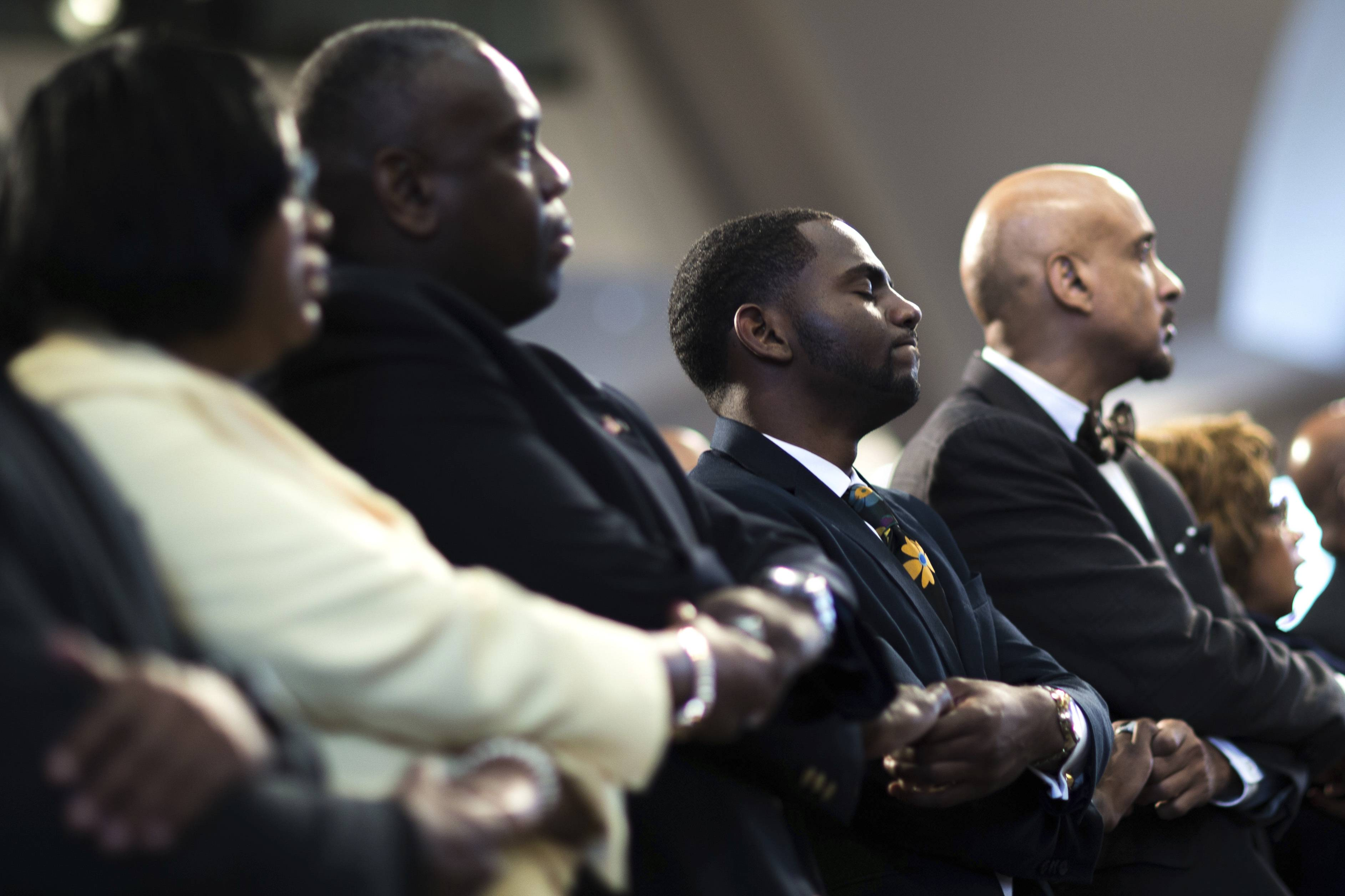 "Audience members join hands while singing ""We Shall Overcome"" during a Martin Luther King Jr. holiday commemorative service at Ebenezer Baptist Church, Monday, Jan. 16, 2017, in Atlanta."