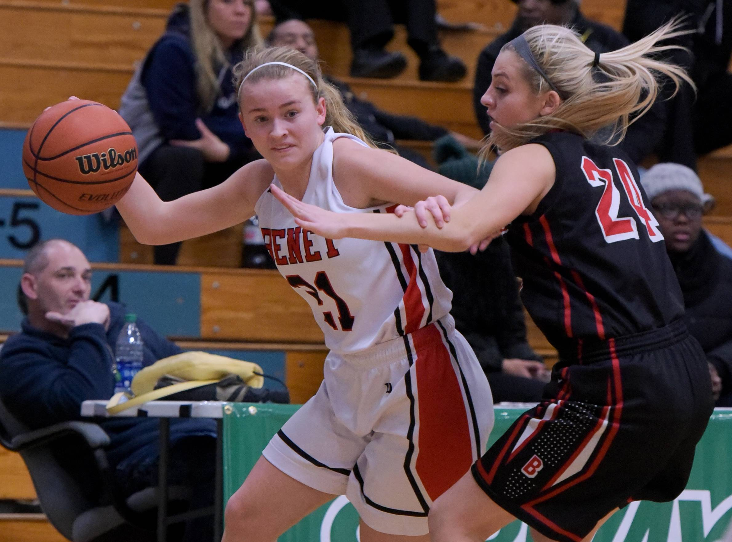 Benet Academy's Clara Prasse pushes past Bradley-Bourbonnais' Camryn BeDell during the Subway Classic girls basketball game on January 16, 2017.