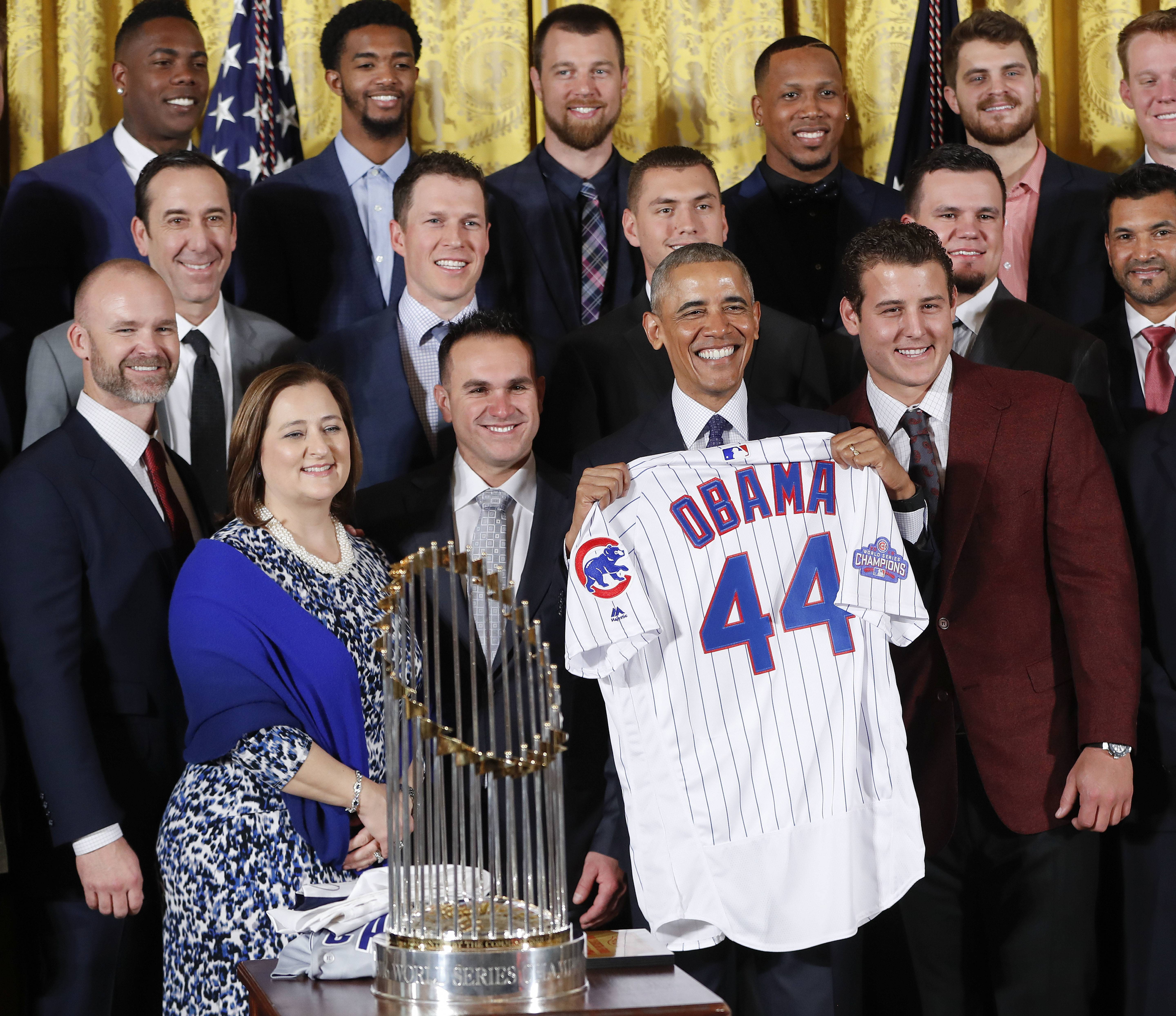 There was a time when the concept of a black president was even more unbelievable than the idea of the Cubs winning the World Series. On Monday's Martin Luther King Jr. Day, President Barack Obama holds up a personalized Chicago Cubs baseball jersey during a ceremony in the East Room of the White House to honor the 2016 World Series Champion baseball team.