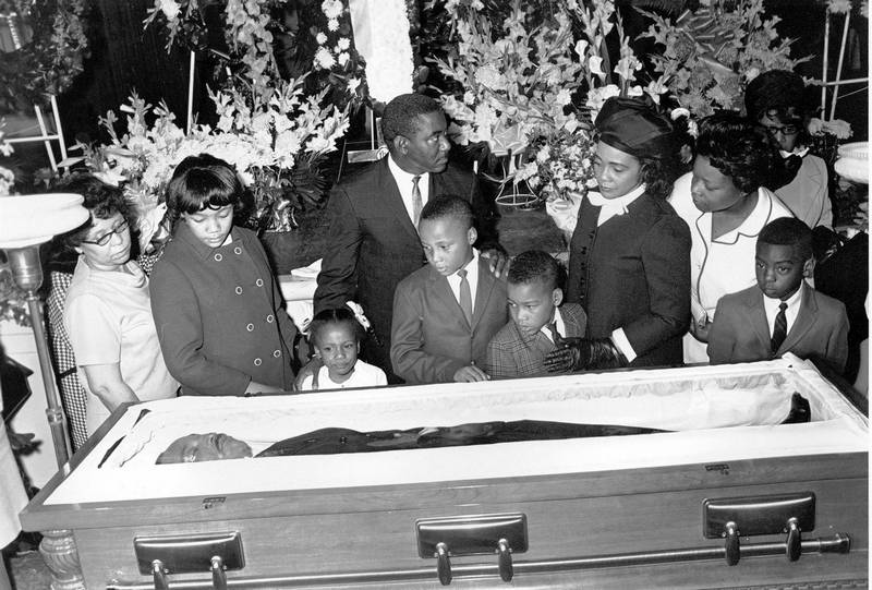 Coretta Scott King and her four children view the body of her husband in Atlanta.