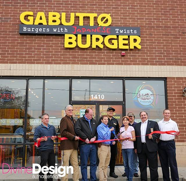 Rolling Meadows city officials, Mayor Tom Rooney and the staff of Gabutto Burger held a grand opening ribbon cutting at the store in the Surrey Ridge Shopping Center, 1410 Golf Road.