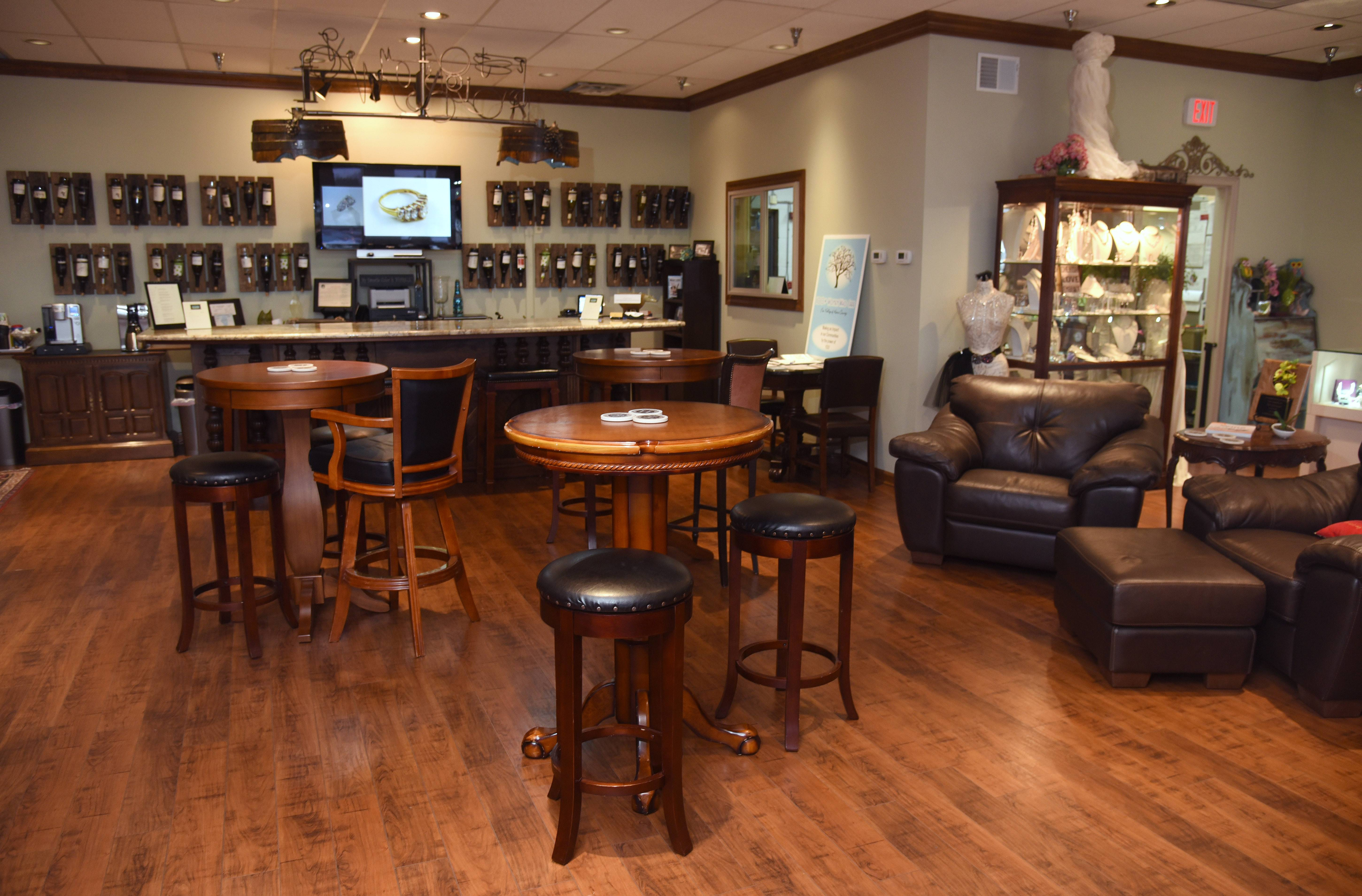 Many businesses are seeking ways to coordinate alcohol consumption with their services, as K. Hollis Jewelers in Batavia did by adding a wine bar.