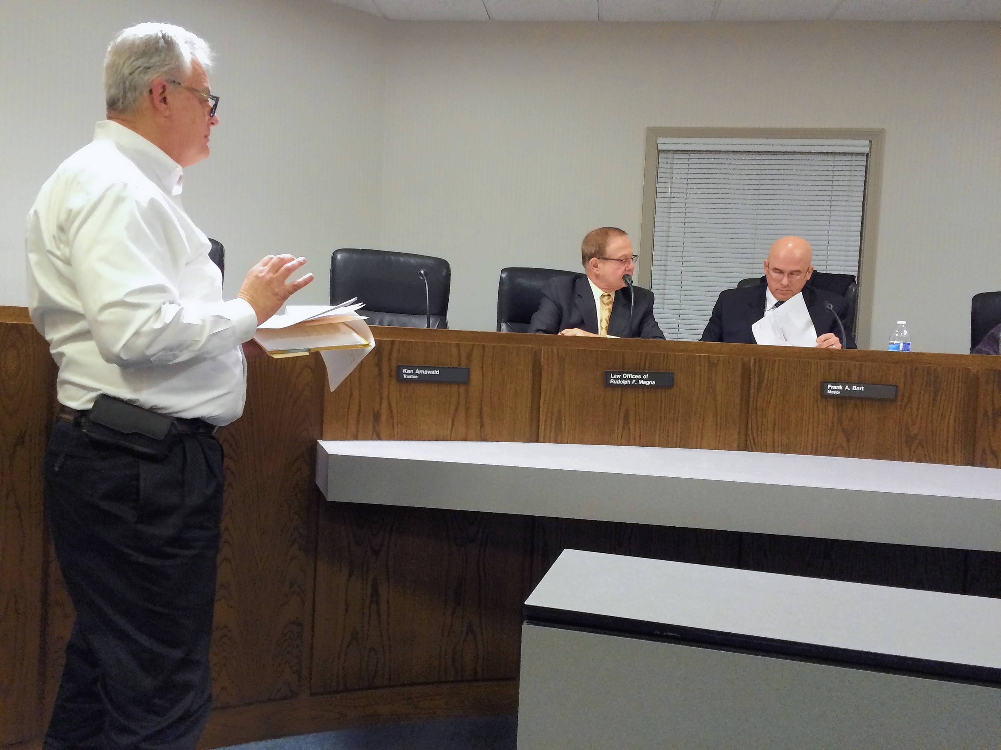 Wauconda trustee candidate Joe Lewis, left, responds to complaints about the validity of a proposed referendum on term limits for the mayor and trustees during an electoral board hearing Tuesday as village attorney Rudy Magna and Mayor Frank Bart listen.
