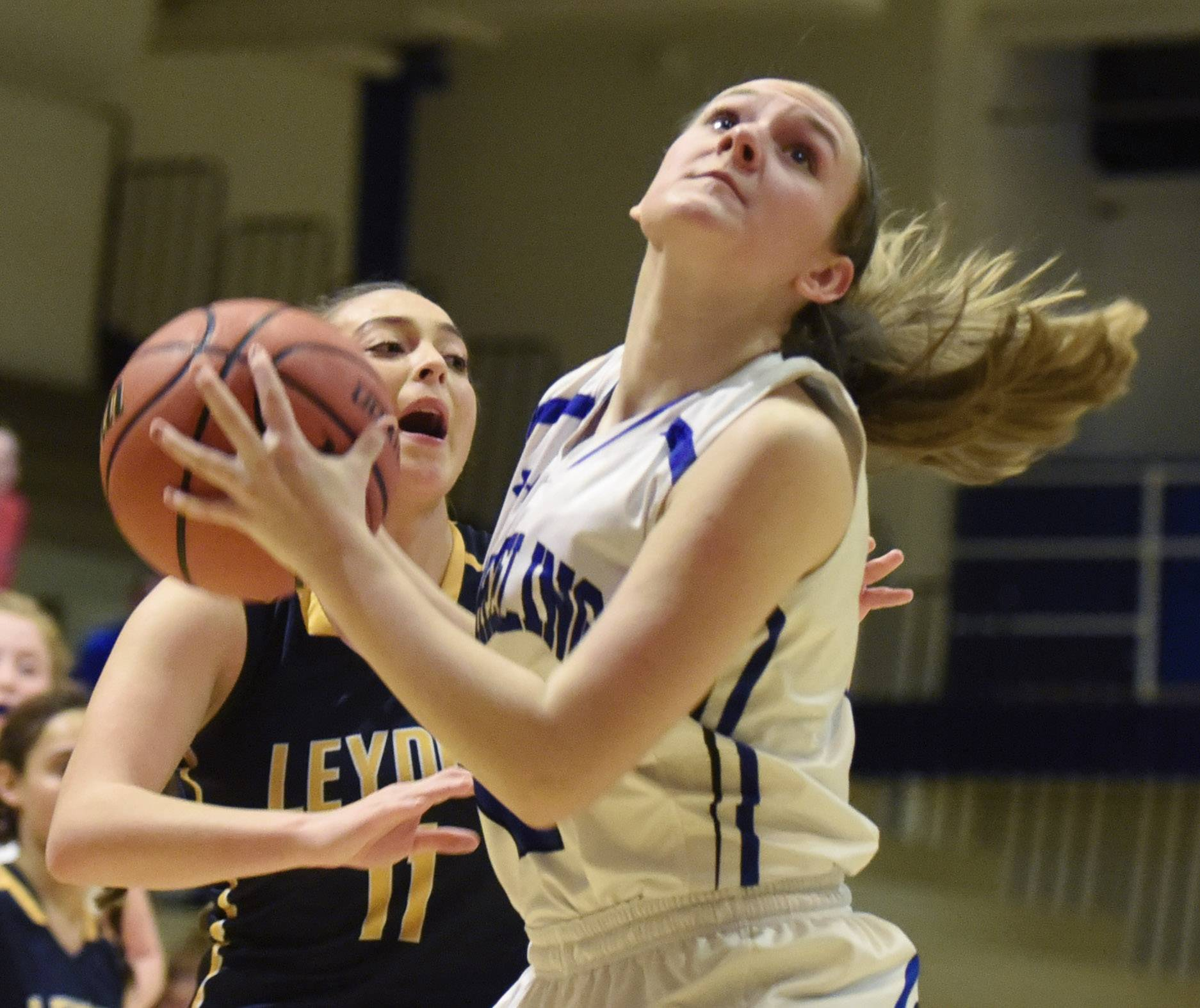 Wheeling's Morgan Collar makes a move to the basket in front of Leyden's Ginani Badillo during Tuesday's game.