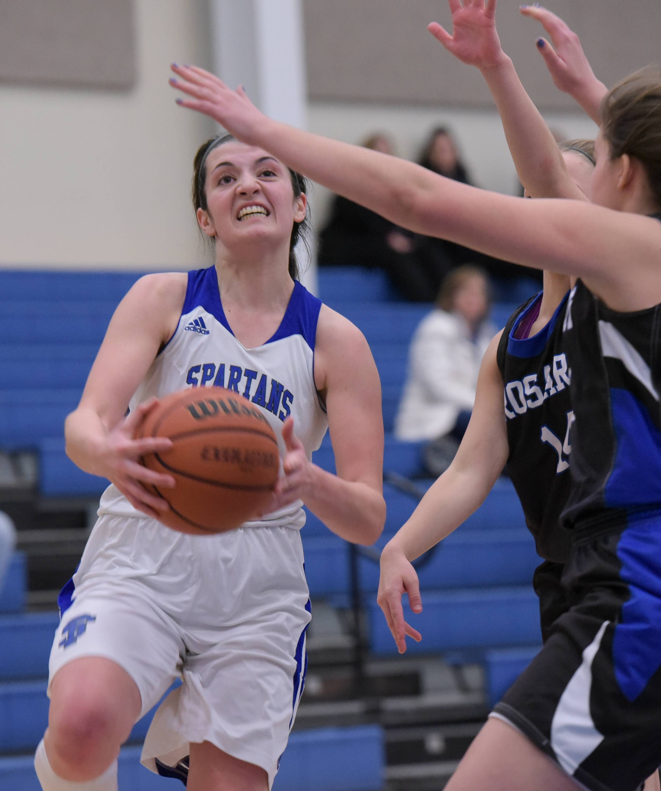 St. Francis' Mia Mazza drives to the basket against Rosary during varsity girls basketball in Wheaton Tuesday.