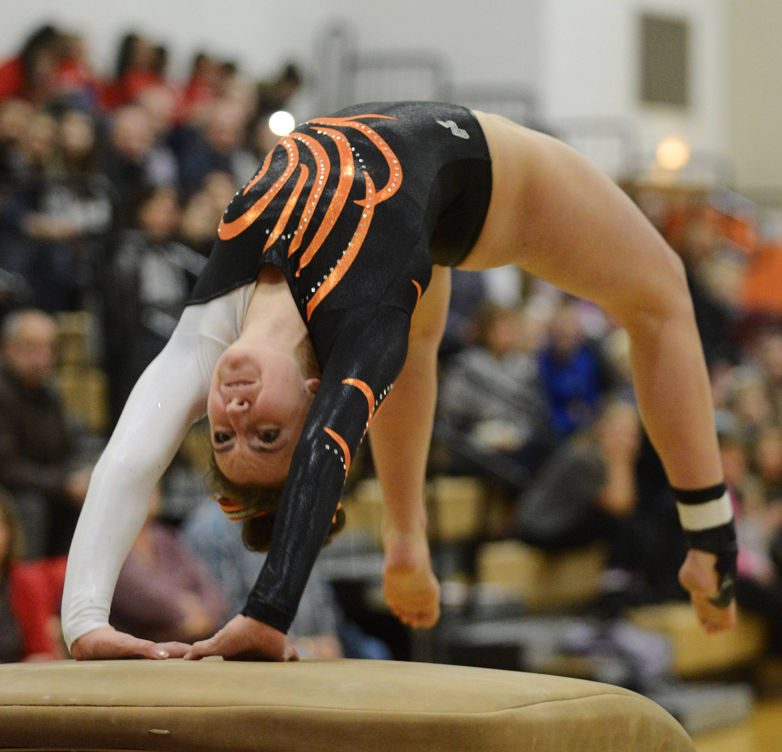 Hersey's Maggie Barton competes on vault during Wednesday's meet in Arlington Heights.