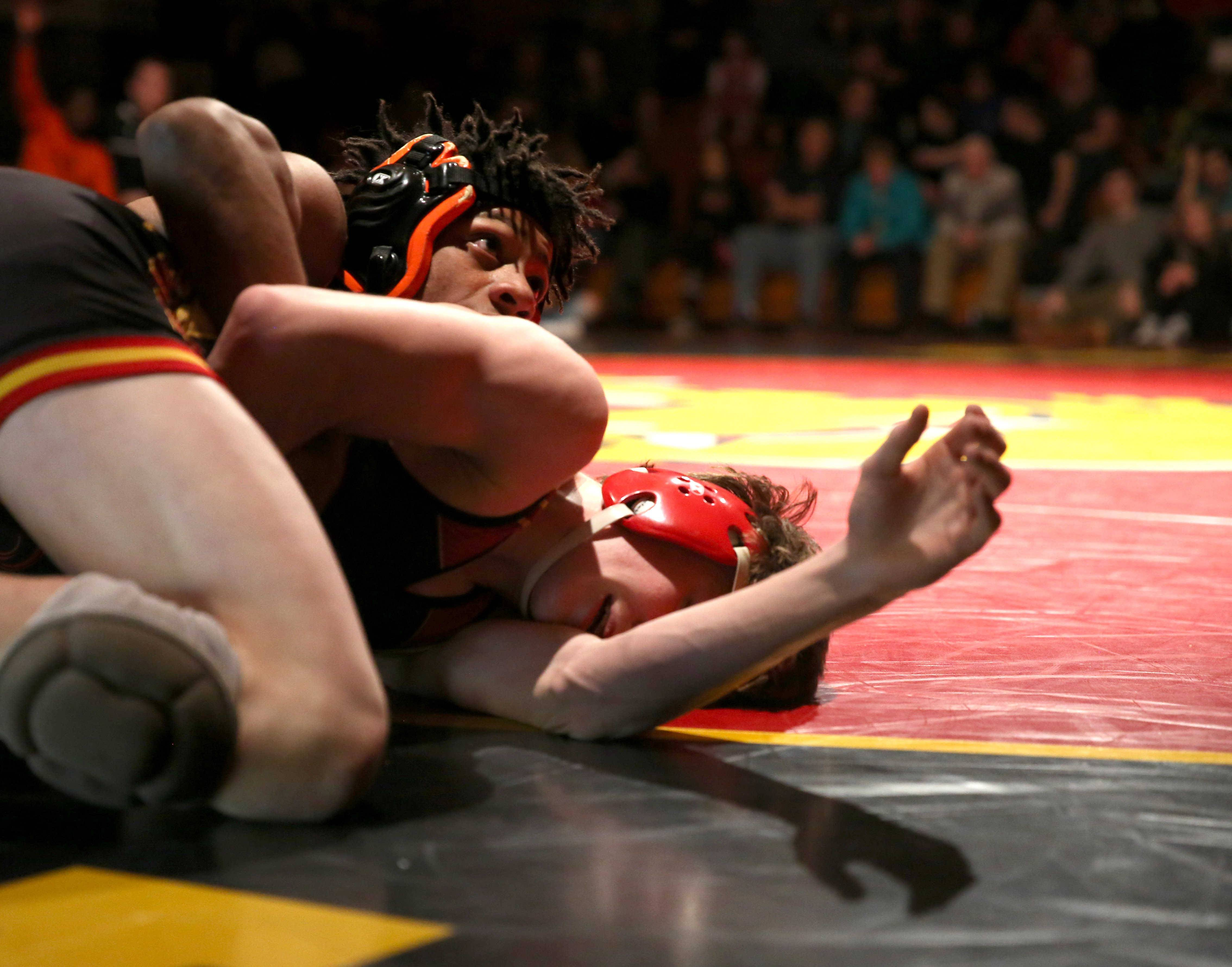 St. Charles East's Louis Gordon, top, controls Batavia's Justin Major at 132 pounds during a varsity wrestling meet at Batavia Tuesday night.