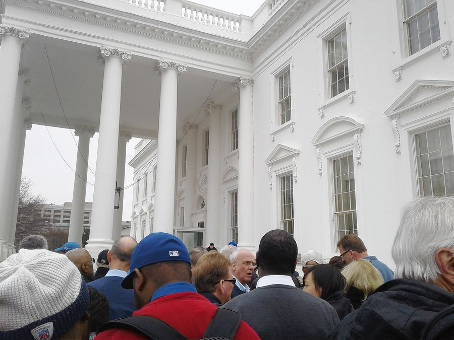 Reporters and others wait to enter the White House on Monday to attend the ceremony to honor the Chicago Cubs, who won the 2016 World Series.