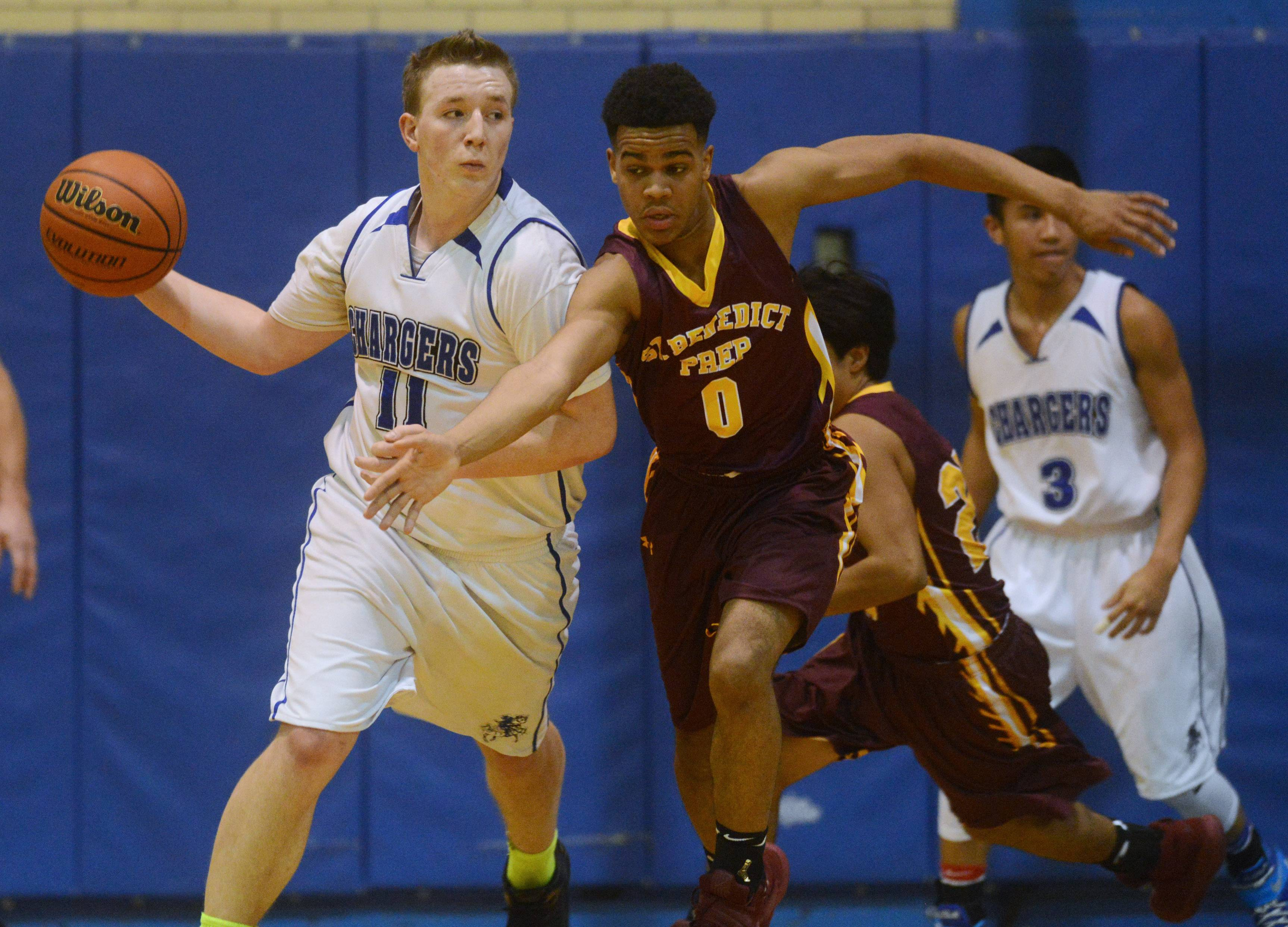 Christian Liberty Academy's Jimmy Cunningham makes a long pass as St. Benedict's Anthony Bradley defends during Wednesday's game in Arlington Heights.