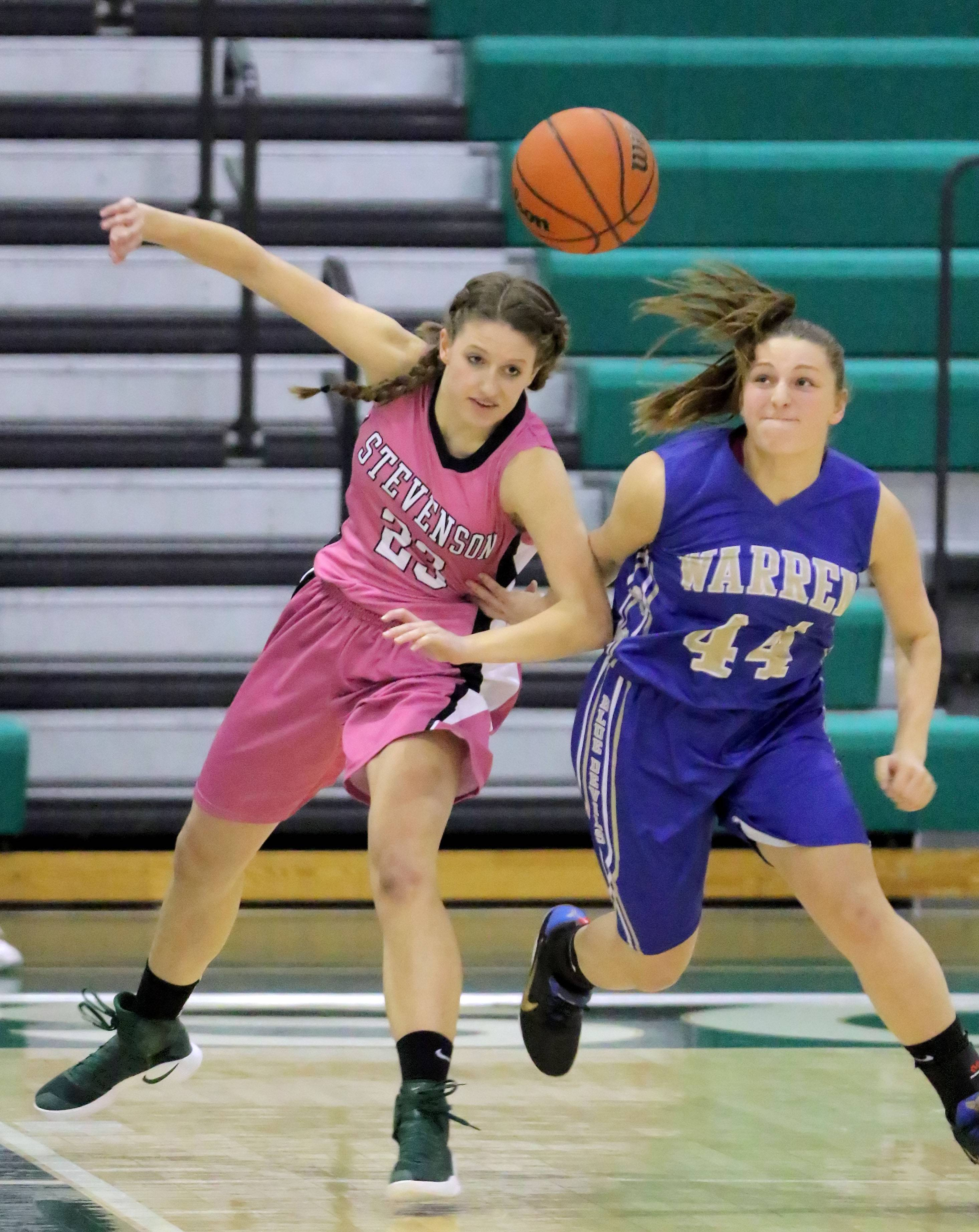 Stevenson's Isabella Paldrmic, left, and Warren's Jordyn Hughes battle for a loose ball during their game Wednesday at Stevenson High School in Lincolnshire.