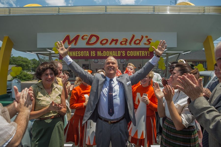 "Ray Kroc (Michael Keaton) takes McDonald's across the country in ""The Founder."""
