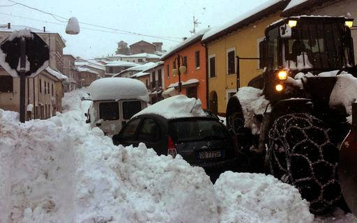 Exceptional snow clogs the roads in Montereale, central Italy, Wednesday, Jan. 18, 2017. Three strong earthquakes shook central Italy in the space of an hour Wednesday, striking the same region that suffered a series of deadly quakes last year and further isolating towns that have been buried under more than a meter (3 feet) of snow for days. The first tremor, with a preliminary magnitude of 5.3, hit Montereale at about 10:25 a.m. (0925 GMT). (Claudio Lattanzio/ANSA via AP)