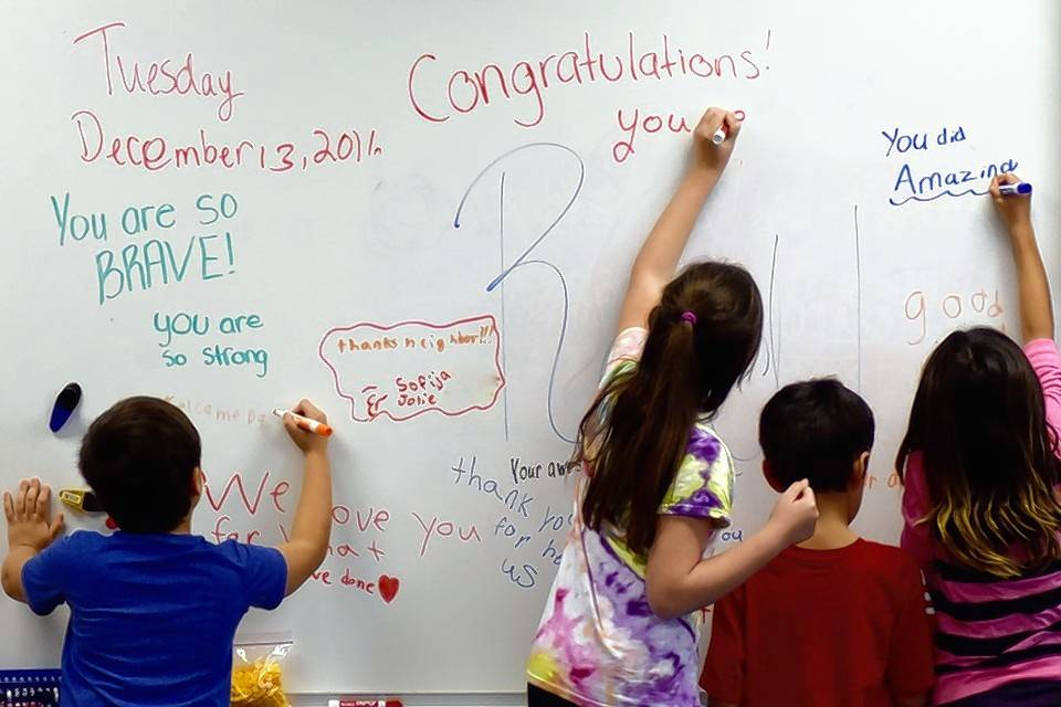 Fifth-graders at Park Campus in Round Lake write notes of appreciation on the classroom whiteboard before Reid Luczak's arrival.
