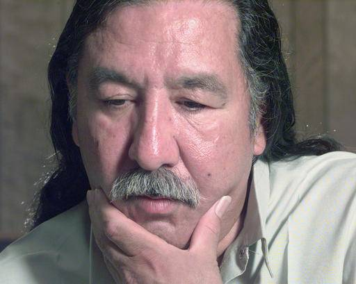 FILE - In this April 29, 1999, file photo, American Indian activist Leonard Peltier speaks during an interview at the U.S. Penitentiary at Leavenworth, Kan. President Barack Obama has denied a clemency request by Peltier, who has spent most of his life in prison in the killing of two FBI agents in South Dakota in 1975. Peltier's attorney, Martin Garbus, says they received a letter from the White House on Wednesday Jan. 18, 2017 saying their application has been denied. (Joe Ledford/The Kansas City Star via AP, File)