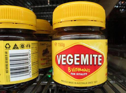 Vegemite are sold at a supermarket in Canberra, Australia, Thursday, Jan. 19, 2017. The salty, brown spread beloved in Australia, is going home, purchased by an Australian dairy company from the maker of Oreos. Mondelez International Inc. says it is selling Vegemite and other Australian and New Zealand grocery products to Bega Cheese in a deal worth about $345.3 million (460 Australian dollars). (AP Photo/Rod McGuirk)