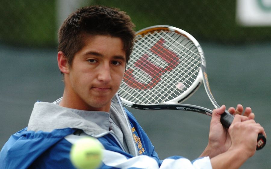 Denis Bogatov returns a shot while competing for Warren in the boys tennis state tournament.
