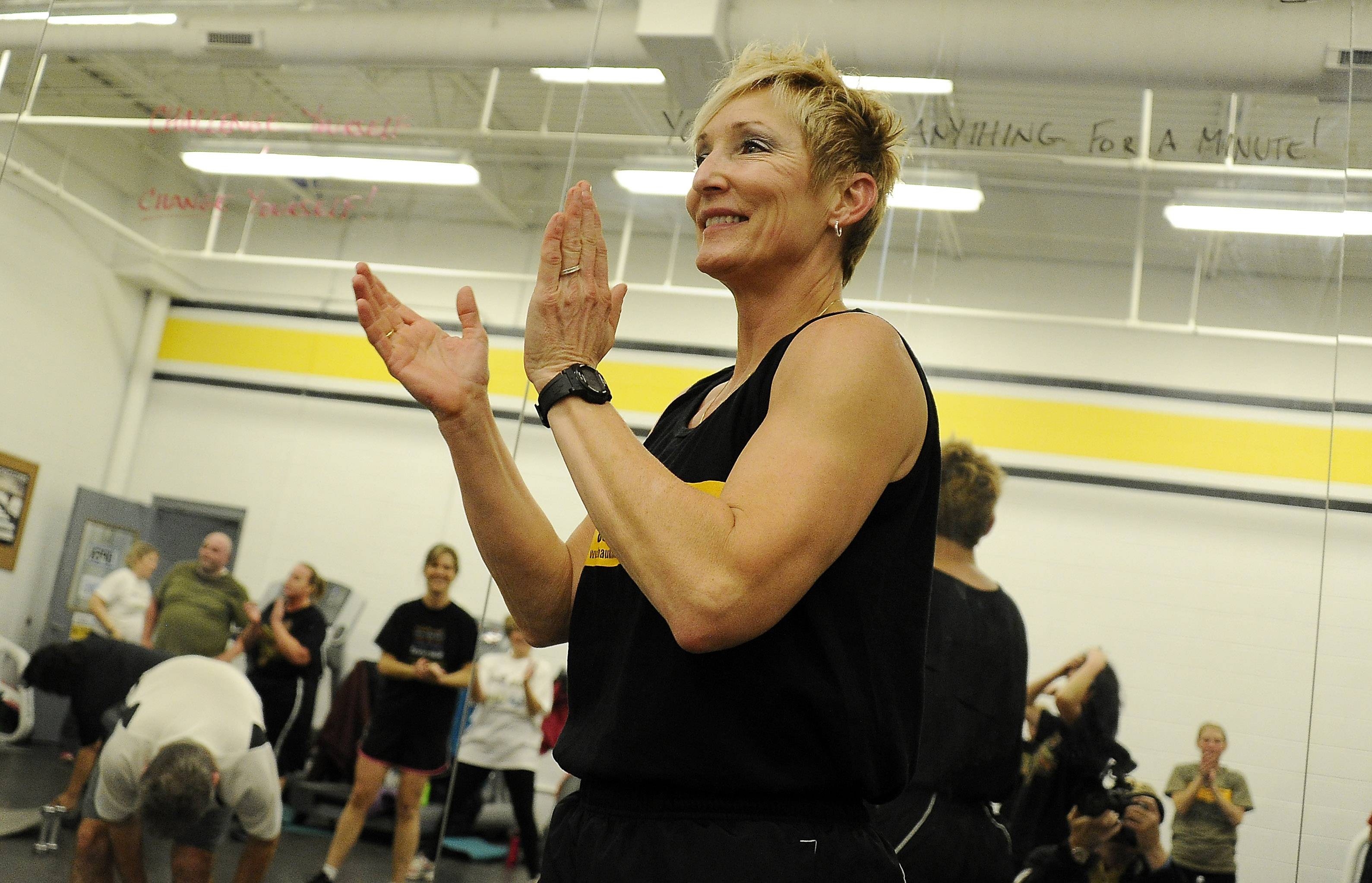Retired Illinois State Police captain Tami Haukdahl cheers on her Train Like a Trooper class as she whips suburban moms and dad into shape at the Rolling Meadows Ice Arena.