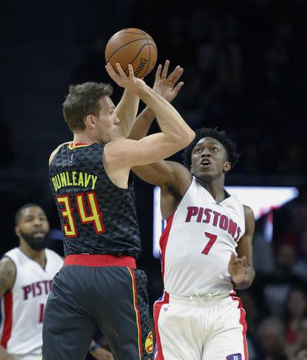 Atlanta Hawks guard Mike Dunleavy (34) looks over Detroit Pistons forward Stanley Johnson (7) during the second half of an NBA basketball game, Wednesday, Jan. 18, 2017, in Auburn Hills, Mich. (AP Photo/Carlos Osorio)
